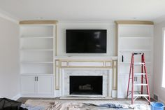 The before and after of a living room makeover with white built-ins flanking a fireplace. Love the addition of built-in bookcases for storage and a place to showcase pretty decor. #builtins #fireplace