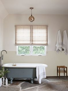 Great idea: Create a wainscoting look -- for less -- by painting the wall two tones.     #decorating #bathroom
