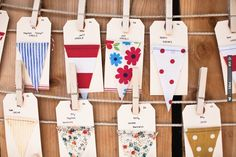 fabric bunting swatches made into escort cards. | CHECK OUT MORE IDEAS AT WEDDINGPINS.NET | #weddings #escortcards #cards