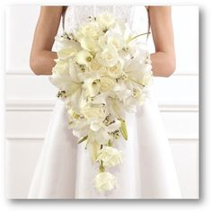 I've always loved the idea of a cascade bouquet, so romantic and traditional. White cascade bouquet with roses, calla lilies and lilies. I like all the different shaped flowers - it sort of reminds me of a wild flower bouquet. Orchid Bouquet Wedding, Cascading Wedding Bouquets, Calla Lily Wedding, Bridal Bouquet Fall, Bride Bouquets, Bridal Flowers, Gladiolus Bridal Bouquet, Seashell Bouquet, Cascading Flowers