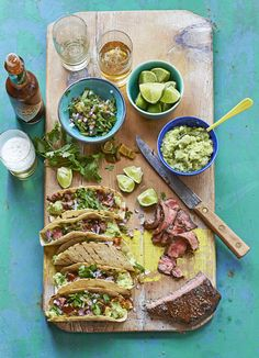 Carne asada tacos with pickled jalapeño and coriander salsa: The best recipe for a Mexican meal. Carne asada, or beef tacos are made with grilled steak and served with guacamole, pickled chillies and a fresh coriander salsa. Assemble on the table and let everyone dig in.