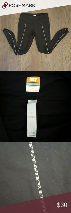 Lucy Powermax Black Leggings Lucy Powermax Black Leggings with cute patterned stripe down the front of each leg. Ruching at the ankles and key pocket at the waist. Good condition no flaws. Lucy Pants Leggings