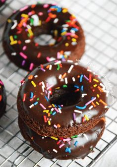 These Baked Double Chocolate Donuts are so easy! Baked chocolate batter gets frosted with an indulgent fudgy glaze and a topping of rainbow sprinkles to make for the most fun sweet breakfast treat.