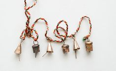 Oh So Tiny and Cute Mixed Windchimes  142 by ironaworks on Etsy, $17.75 / Says they are handmade.