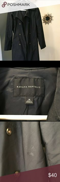 Banana republic navy blue trench jacket Hardly used Banana Republic navy blue trench jacket! Medium water resistant. Would be perfect condition except the third picture shows a little marking. I don't know what it is and I never tried to get it out. Maybe dry clean?  Price reflects damage. Comes from a non smoking environment! ?? trades. Price negotiable !!!???? Banana Republic Jackets & Coats Trench Coats