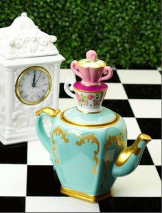 """Tea time with a twist! Inspired by Disney's """"Alice Through the Looking Glass"""" David's Cookies brings us their most unique cookie jar yet!"""