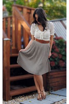 perfect example of a multi functional outfit. A slightly detailed white shirt tucked in a flowy skirt with a belt to make the two look one. Great way to cut back on the cost of outfits