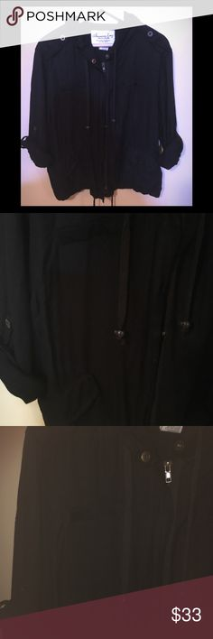 American Rag pull over draw string style athletic Super cute athletic pull over  Like new  Black with buttons & zip  Hoodie  Great to wear to yoga Macy's bought  Sz Large  Reg $100 American Rag Tops