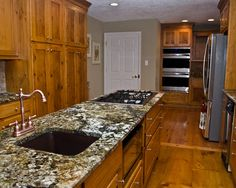 Inspiring Eclectic Kitchen With Charming Knotty Pine Kitchen Cabinets Also  Classic Faucet And Mix Tray