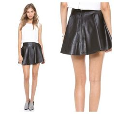 By Chance Black Faux Leather Skirt, S Large! Faux leather By Chance skirt with a flounced fit-and-flare silhouette and fun exposed back zipper.  Size Large. Lined. Length: 16in / 40.5cm Skirts