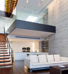 Modern Minimalist New York Triplex Apartment Dramatic Interior With Wo Story Vals Quartzite Stone Wall And Double Height Entry Foyer Also Overhang Deck: New York Apartment with Modern Minimalist Decoration