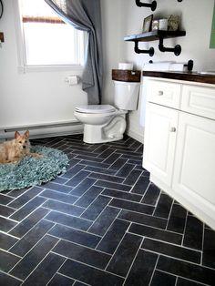DIY Herringbone Floor Using Peel n' Stick Luxury Vinyl Tile! http://sharktails.ca/2016/01/10/herringbone-floor/