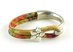 This beautiful vegan jewelry Portuguese cork leather cuff bracelet with silver flower bead is made from multi colored cork cord and highest quality antiqued metal cast Zamak silver hook clasp. Zamak is a metal alloy that is hypoallergenic, certified lead and nickel free. Made to any bracelet size you choose in the drop down menu.  EASY SIZING: Wrist size without slack + wiggle room (no more than 1/4) = YOUR BRACELET SIZE! So if wrist measures 7 you need to order size 7 1/4. (Ma...