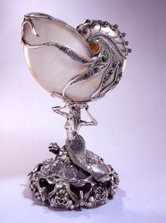 Nautilus with mermaid base overlaid with silverwork and gemstones. It appears to have a squid or octopus as well as a turtle on the base. Concha Nautilus, Nautilus Shell, Seashell Art, Seashell Crafts, Art Nouveau, Shell Decorations, Bijoux Art Deco, Art Object, Oeuvre D'art
