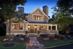 Craftsman Exterior of Home with Transom window, exterior stone floors, Glass panel door, Natural stone pathway, Pathway