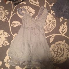 Free People Lace Eyelet Dress This is in perfect condition. The small discoloration is on the inside hem and is NOT seen at all. I am mostly looking to trade this for a small or a medium because this is a bit too small on me. Free People Dresses