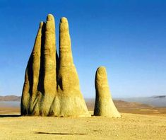 'Hand of the Desert' (c 1980). In the desert, about 75km south of the town of Antofagasta, Chile, a 36' tall hand protrudes out of the sand. 'Mano de Desierto' is a work of the Chilean sculptor Mario Irarrázabal. via travel and leisure