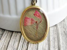 Pressed Flower Necklace Valentines Day Pink Coral Bell Flowers Bridal Botanical Jewelry Resin Plant Pendant Naturalist Gift. $29.00, via Etsy.