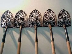 We usually think of shovels as tools for creating the art of a garden, but in this case artist Cal Lane has turned them into works of art themselves.