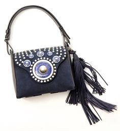 Tasseled and studded with semi-precious stones and ornaments | www.toryburch.com/runway