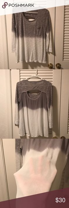Grey and white semi long sleeve blouse Grey and white semi long sleeve blouse  It does accentuate your curves it does not just hang flat down. The sleeves do not fully touch the wrist they go about 75% down my arm and I am 5'7 with long arms.  The back fabric is a little different not quite sure what it is but it's very soft and light and a little see through. It is a M but can fit M/L. Only worn a few times. Does not shrink. language Tops Blouses
