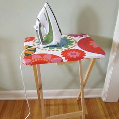 I love ideas like this. Totally practical, completely usable and cute too. This little side table ironing board is perfect for those sewing projects you've been meaning to complete. No more lugging out the ironing board folks. Check it out at Just Crafty Enough