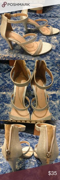 Kelly & Katie size 5 silver sparkly sandals Size 5 strappy heeled sandals by Kelly & Katie worn only once for a wedding--perfect condition! Kelly & Katie Shoes Heels