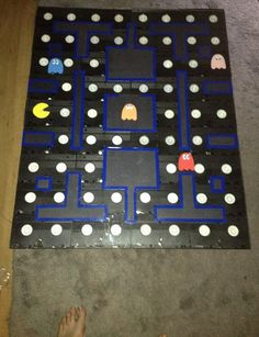 Check out this awesome Pac-Man Coffee table. I'm gonna set my energy drink right there in the corner where the power pellet should be. Then when I drink it, I'mma go all crazy up in here and start chomping ghosts. And by ghosts, I mean Hot Pockets, b