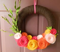 Yarn-wrapped spring wreath.  I NEED to do this!  So cute!  (Easter-weekend project!)