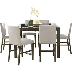 Gather friends and family with this chic dining set, showcasing 6 upholstered Parsons chairs and a counter-height table.Product: ...