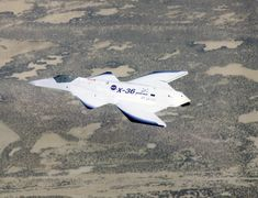 The unusual lines of the X-36 technology demonstrator contrast sharply with the desert floor as the remotely piloted aircraft scoots across the California ...
