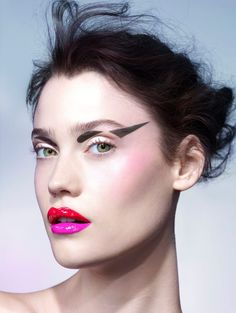 Exaggerated graphic black for the eyes and lips in two tones with red on the top lip and hot pink on the bottom. #makeup