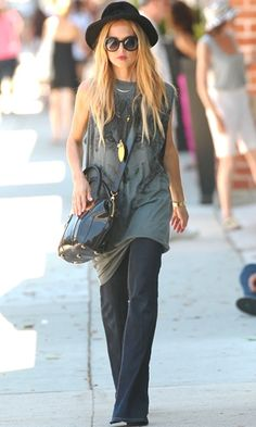Rachel Zoe. How is she pulling off an oversized wolf muscle shirt and a fedora? Amazing.