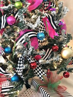 How to add mesh and ribbon to a Christmas tree - black and white themed tree - black and white striped Christmas tree - jester diamond Christmas decor - hot pink Christmas tree - whimsical Christmas tree decor - colorful Christmas tree Whimsical Christmas Trees, Unique Christmas Trees, Ribbon On Christmas Tree, Christmas Tree Design, Christmas Tree Themes, Pink Christmas, Christmas Tree Ornaments, Christmas Mantles, Christmas Villages