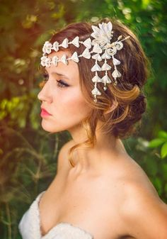 This design combines ivory floral lace and silk flowers, complemented by golden honey coloured Swarovski crystals and cream pearls. Description from etsy.com. I searched for this on bing.com/images