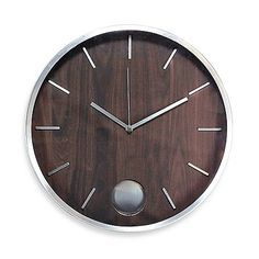 A chic, walnut veneer dial and brushed silvertone accents creates a sophisticated timepiece perfect for accenting your home with. A matching silver pendulum gives this wall clock a timeless look and feel.