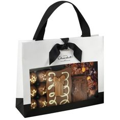 When I first entered Hotel Chocolat's site, the first thing I was stroke by was the great diversity of package designs, each having its unique beauty. Furthermore, their Christmas package designs are absolutely gorgeous and I'm pleased that I could sha… Dark Chocolate Bar, Chocolate Gifts, Christmas Chocolate, Goodie Bags, All Things Christmas, Packaging Design, Goodies, Tote Bag, Pantry