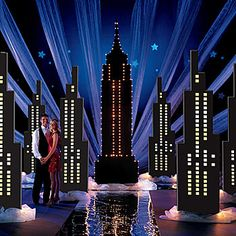Our Still of the Night Theme Kit features towering skyscraper columns and a lighted Empire State Building. Bring the fun and romance of New York City to your event with this fabulous kit. New York Party, Dance Decorations, Dance Themes, Homecoming Themes, Homecoming Decorations, Homecoming Dance, Broadway Theme, City Dance, Still Of The Night