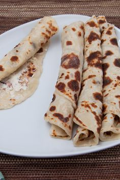 Rolled lefse with butter and sugar on a plate. A Norwegian classic served all over Norway