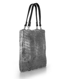 Stunning aluminum pop top bags by Escama Studio. The bags are hand-crocheted by local women collectives and can use thousands of pop tops per bag.  A brilliant, innovative way to recycle – oh yeah, and gorgeous!  www.escamastudio.com