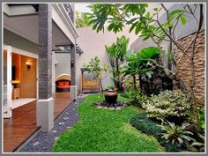 Have an empty space at your side yard? Just create a minimalist modern garden! Add some decor like small water fountain or wooden bench to beautify your dreamed garden. Read: http://edupaint.com/eksterior/taman/9906-menjaga-kebersihan-taman-untuk-kesan-menawan.html #HiyotoIdea #homegarden #housegarden #gardendesign #gardendecor #exteriordesign #homedesign #housedesign