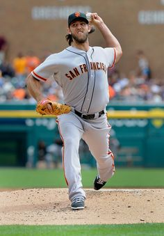 San Francisco Giants pitcher Madison Bumgarner throws against the Detroit Tigers in the first inning of a baseball game Saturday, Sept. 6, 2014, in Detroit, Mich.  (AP Photo/Jose Juarez)