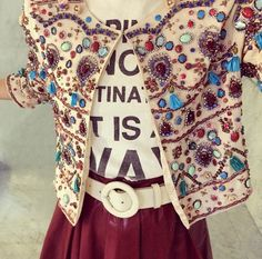 Bejewelled jacket and white tee.