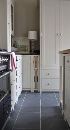 Ca Pietra. Gorgeous full-height cabinetry, custom tray and cutting board slots