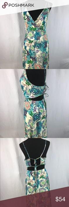 Floral Print Maxi Dress 👗 Gorgeous NWT Floral Spaghetti Print Dress 👗 Cutout sides ❌🐶🐱🚭 ❌ holes, imperfections, tears or rips noted Romeo & Juliet Couture Dresses Maxi