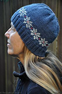 Cozy Snowflake Hat is a free hat pattern with a small snowflake motif above the ribbed brim.
