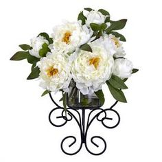 "White silk peony in a scrolling vase.     Product: Faux floral wall decor   Construction Material: Silk, glass and iron   Color: White Features: Includes faux peonies   Dimensions: 13.5"" H x 12"" W x 7.5"" D"