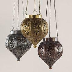 Mixed metal hanging lanterns, set of 3, $30. World Market Small Voyage Punched Metal Lanterns.