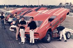 This is a beautiful sight indeed: a lineup at Orange County International Raceway, most likely for the Manufacturer's Funny Car Race. In the photo is Gas Ronda and his funny car backed by Russ Davis Ford.