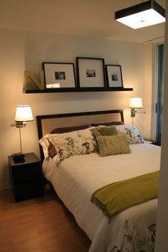 Add a large floating shelf over a bed to display personal photos and precious mementos. Place the shelf high enough so that you don't hit your head when sitting upright in bed.